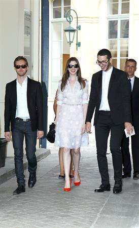 Anne Hathaway Givenchy private show for Anne Hathaway then visiting Chopard Jewelry in Paris on July 6, 2011