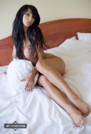 Anna Jachniewicz posing on a bed