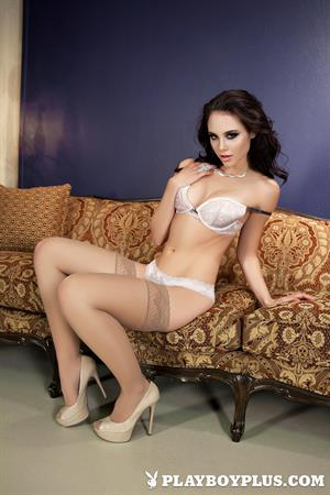 Playboy Cybergirl Iana Little takes off white lingerie