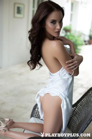 Playboy Cybergirl Jasmin outside in white