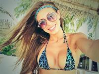 Galinka Mirgaeva in a bikini taking a selfie