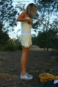 Johanna stripping down outside