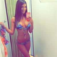 Carlie Jo in a bikini taking a selfie