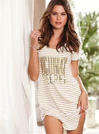 Behati Prinsloo wearing white striped Victoria's Secret shirt