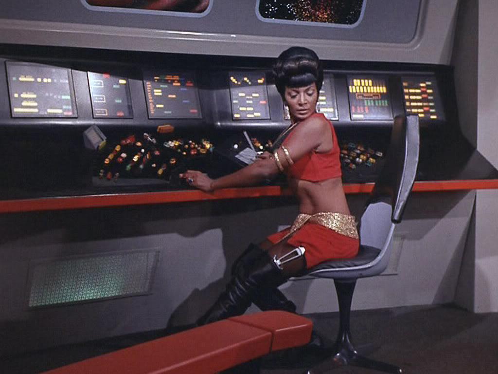 Nichelle Nichols as Lt. Uhura wearing something skimpy on the Star Trek Bridge