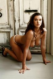 Alice Goodwin in front of old wooden doors