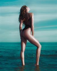 Kyra Santoro in a bikini - ass