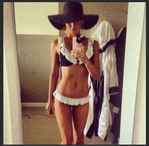 Sheridyn Fisher in a bikini taking a selfie