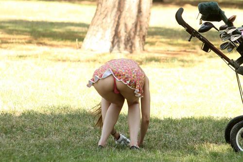 Alicia Arden golfing in a tiny skirt.  Upskirt pink panties.