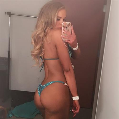 Courtney Tailor in a bikini taking a selfie and - ass