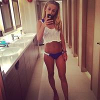 Tiffany Watson in a bikini taking a selfie
