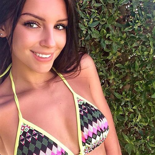 Galina Dubenenko in a bikini taking a selfie