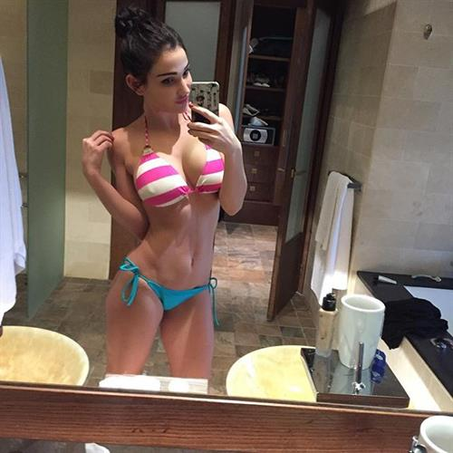 Kristina Basham in a bikini taking a selfie