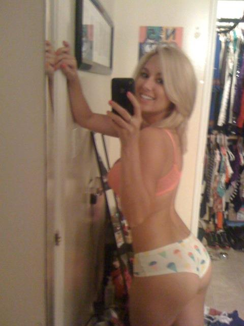 Amy Leigh Andrews taking a selfie and - ass
