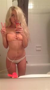 Naomi Woods in a bikini taking a selfie