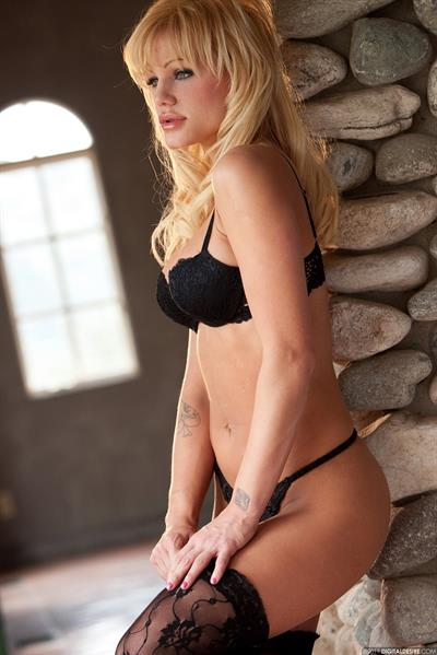 Rhian Alise in black lace stockings and g-string lingerie