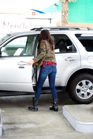 Selena Gomez at a gas station in Los Angeles November 17, 2012