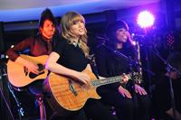 Taylor Swift performs at a private concert for NRJ on a barge on The Seine January 28, 2013