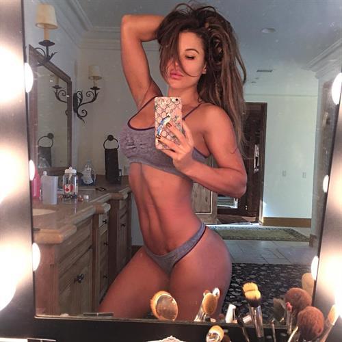Julia Gilas in a bikini taking a selfie