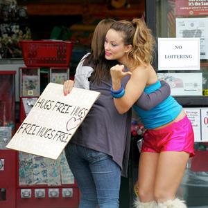 Olivia Wilde in shorts on the set of film free hugs in California July 29, 2011