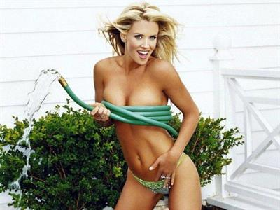 Jenny McCarthy playing with a hose in bikini bottoms