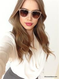 Xenia Tchoumitcheva taking a selfie