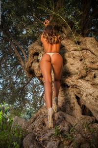 Dana Harem in a bikini - ass