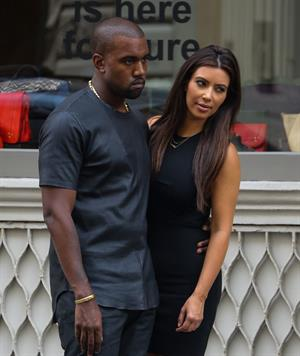 Kim Kardashian and boyfriend Kanye West walk around SoHo in New York City. They stopped at Alexander Wang to do some shopping. August 8, 2012