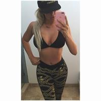 Aubrey O'Day in a bikini taking a selfie