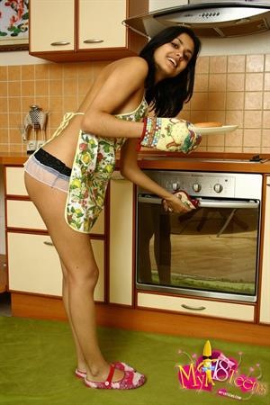 Belinda A nude in the kitchen