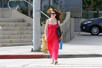 Alyson Hannigan in a red dress in Santa Monica on August 20, 2012