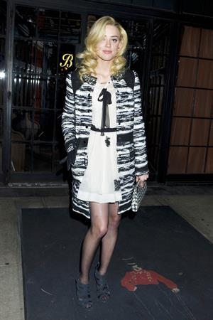 Amber Heard grabs a taxi on a night out in New York City on December 11, 2011