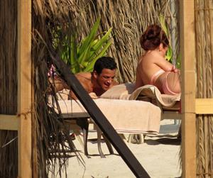 Amy Childs sunbathing with Peter Andre in Dubai on January 3, 2012