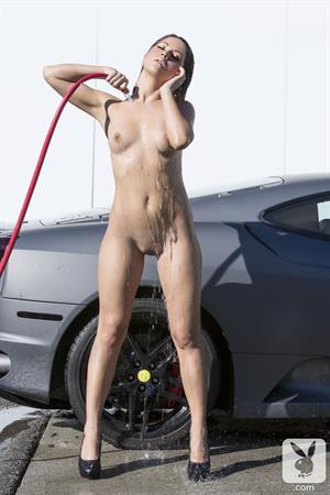Kimberly Kisselovich washes a car for Playboy Plus