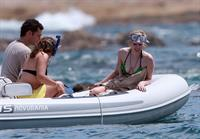 Avril Lavigne in a green bikini in Cabo, Mexico on July 27, 2012