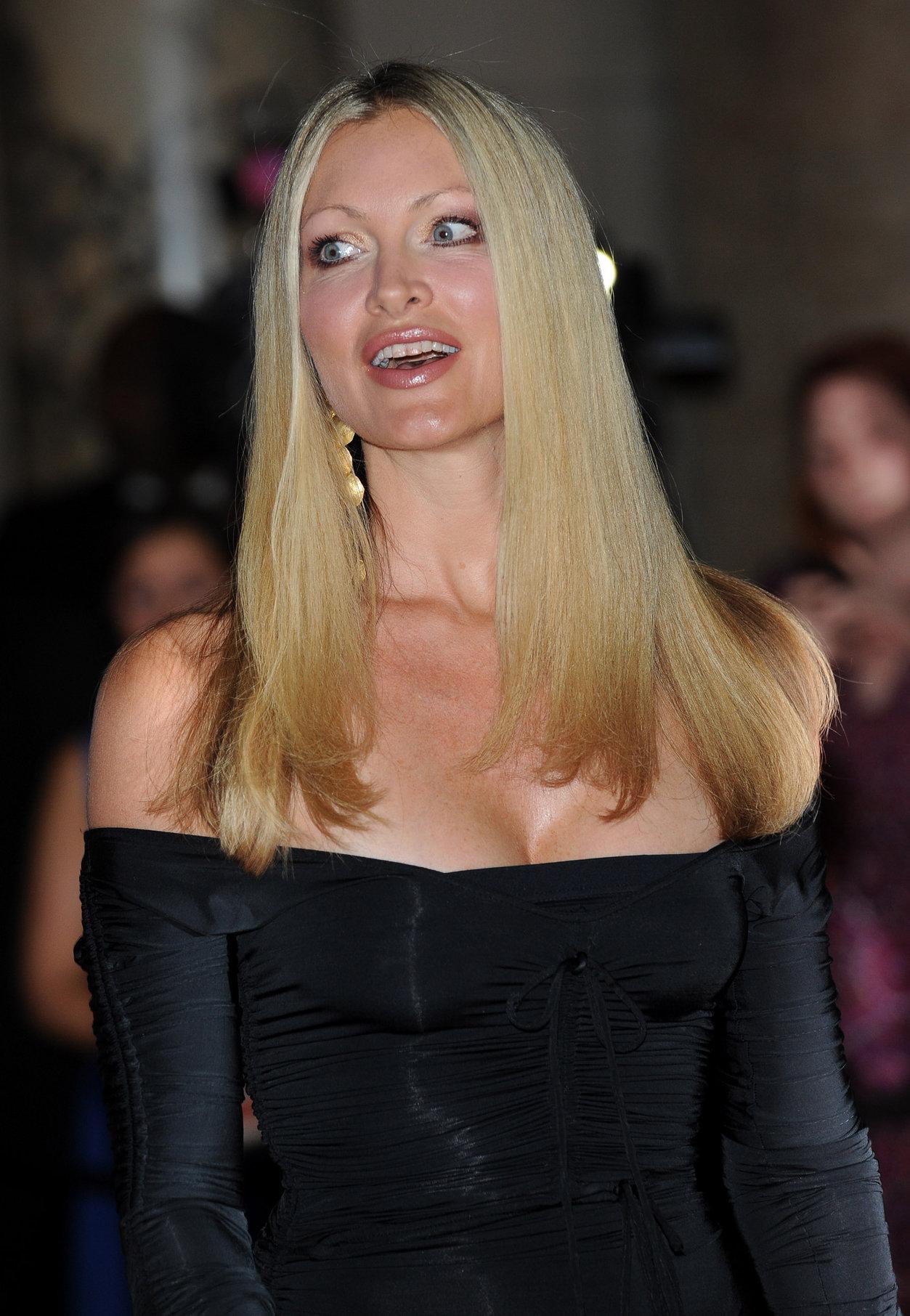 Caprice Bourret in a black dress