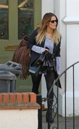 Caroline Flack leaving her London home on December 9, 2011