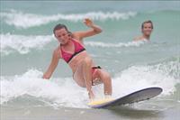 Daniela Hantuchova bikini beach surfing candids in Brisbane, Australia, December 26, 2012