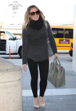 Hilary Duff departing on a flight at LAX Airport 2/18/13