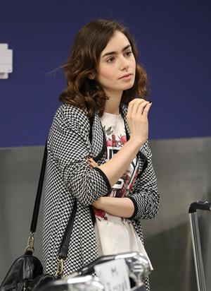 Lily Collins - LAX Airport 8/27/13
