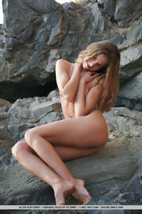Altea B in  Edana  displays her slender, naked body as she poses sensually by the beach.