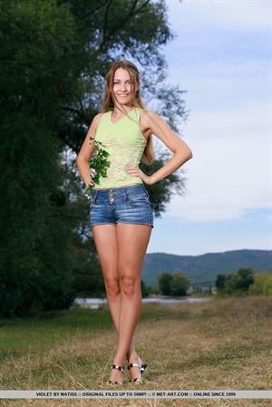 Violet in  Kezara  for MetArt - Violet playfully poses in the field as she flaunts her slender body.