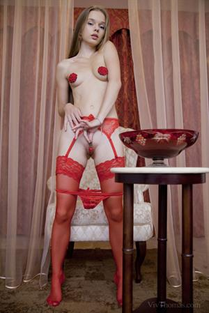 Milena D in  Lady In Red  for Viv Thomas - Milena D poses in bright red, lace lingerie and matching stockings