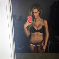 Sarah Louise Harris in a bikini taking a selfie