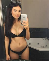 Nicole Thorne in a bikini taking a selfie