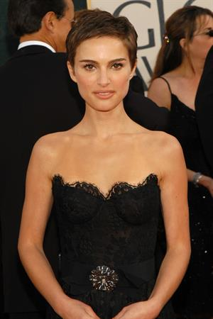 Natalie Portman with short hair and a black dress at the Golden Global Awards