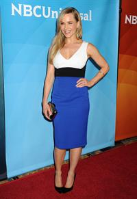 Julie Benz in a blue and white dress for NBC Universal