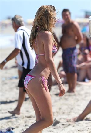 Doutzen Kroes enjoys a day on the beach in Miami Beach, FL on April 28, 2013