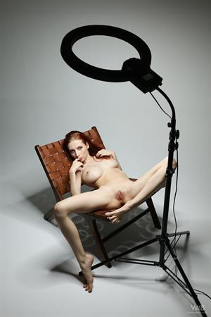 Helga Grey posing naked in a chair