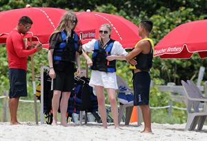Chloe Grace Moretz candids in a Black Bikini in Miami Beach